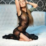 One of the Ankara escort girls Lina is sitting on the bed showing her half-Asian and half-European face to your sight